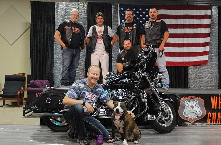 Back, from left, Wheel Dawgz Members Bill Shepard, Norm Taylor, Randy Graham, Jim Flynn. Middle, President Justin Boes. Front, from left, Justin Growden, a veteran, and Princess. (File photo by Anna Skinner)