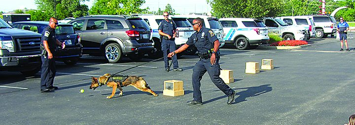 Officers at last year's Jake Laird Community Day put on a K-9 demonstration. (File photo by Sadie Hunter)