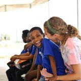Amy Bennett spends time with Davidson, a Haitian boy, during her 2012 trip to Haiti through Grace Church. (Submitted photo)