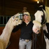 Nancy Noel pauses with two of her animals at her Zionsville farm. (Photo by Theresa Skutt)