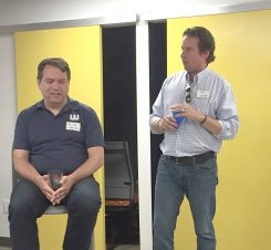 Rick Wehrle talks about his successes with Work Here, and Dan Moyers, right, observes. (Photo by Anna Skinner)