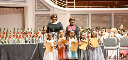 The youngest winners of the solo elementary category included, from left, Samantha Ke, Erica Lai, Rachel Zhor, Aksana Adilet-Sultan and Aisalkyn Adilet-Sultan. They stand with judges Irina Mints, from Germany, and Tanya Kozlova, from Israel. (Submitted photo)