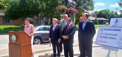 Indiana Dept. of Transportation Commissioner Brandye Hendrickson is joined by, from left, Carmel Mayor Jim Brainard, Lt. Gov. Eric Holcomb, Noblesville Mayor John Ditslear, Westfield Mayor Andy Cook and Fishers Mayor Scott Fadness Aug. 22 in Carmel to announce the Hamilton County cities are receiving a combined nearly $3.5 million in matching funds from the state for road projects. (Photos by Sam Elliott)