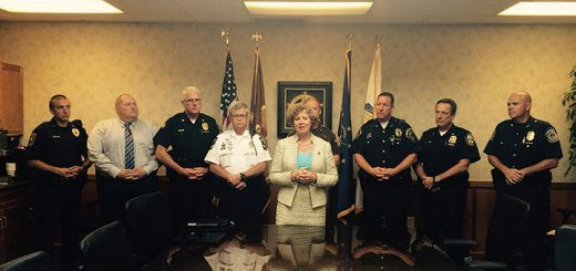 Rep. Susan Brooks, center, stands with local police chiefs. (Photos by Mark Ambrogi)