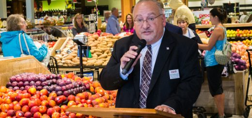 Senior Vice President of Human Resources for Marsh Steve DerManuelian speaks before a crowd at Marsh for the ribbon cutting. (Photo by Jason Conerly)
