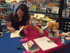Sydney Scrogham autographs a copy of her book, 'Chase.' (Submitted photos)