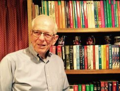 Marvin Bittinger in his library full of his math textbooks. (Photo by Mark Ambrogi)