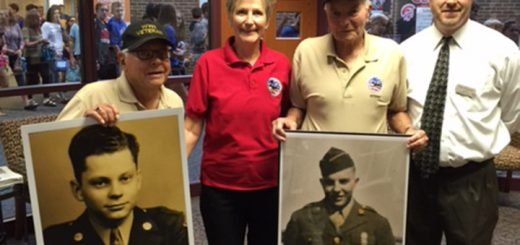 Ned Hugus and Harold Harrington hold their military photos alongside Carol Ford and J. Dan Patane. (Submitted photo)
