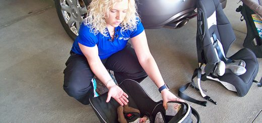 St.Vincent Fishers' certified car seat technician Amanda Craft demonstrates proper methods for strapping baby volunteer Kooper Noone into her car seat before showing how to properly install the seat into a vehicle. (Photo by Sam Elliott)