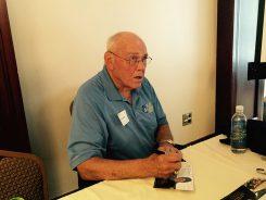 Gene Keady signs autographs at The Bridgewater Club luncheon July 21. (Photo by Mark Ambrogi)