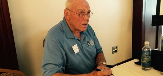 Gene Keady signs autographs at The Bridgewater Club luncheon July 21. (Photo by Mark Ambrogi)