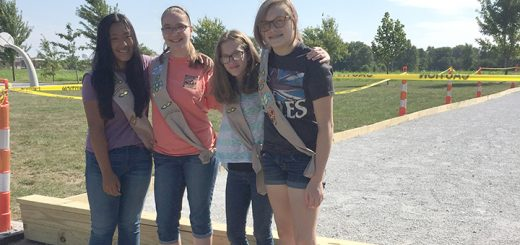 From left, Sierra Cain, Stephanie von Bulow, Erin Byers and Madigan Hester pause in front of their newly constructed bocce ball court at Quaker Park. (Photo by Anna Skinner)