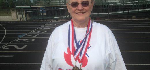 Carol Zuccaro displays medals won in the 2015 Senior Olympics. (Photo by Mark Ambrogi)