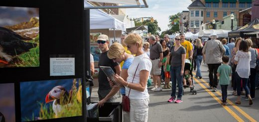 Patrons browse art during the 2015 Carmel International Arts Festival. (File photo)