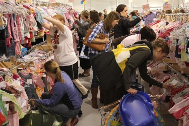 Shoppers look through children's clothes at Indy Kids Sale in Noblesville. Lori Chandler, founder and owner of Indy Kids Sale, said the consignment sale occurs twice each year for three days in March and Sept. Chandler said there will be approximately 50,000 to 60,000 children's items for sale. At the end of the sale, donated items will go to the Good Samaritan Network of Hamilton County. (Submitted photo)