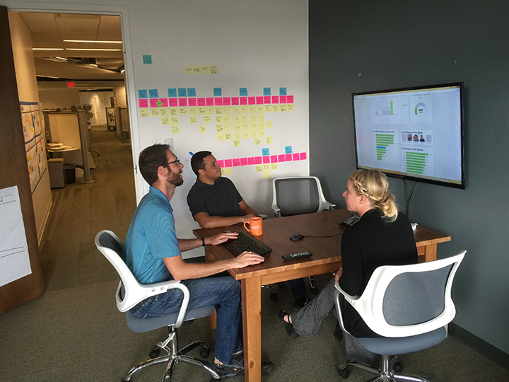 SEP team members Jon Fuller, Kelly Wilson and Matt Loria evaluate their company's H2W dashboard. (Photo by Ryan Schade)