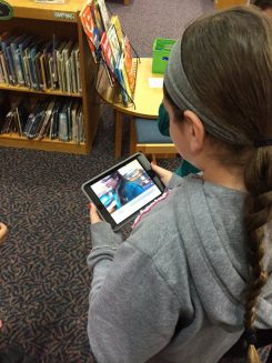 A student at Cherry Tree Elementary works on a project using an iPad in the Media Center. (Submitted photo)