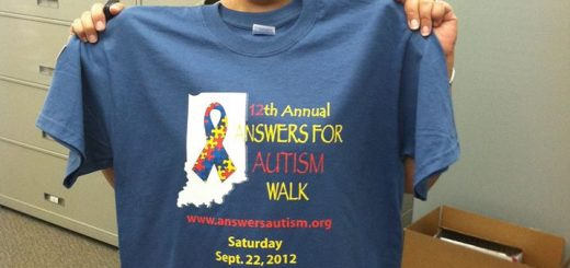 Patty Reed displays an Answers for Autism Walk T-shirt. (Submitted photo)
