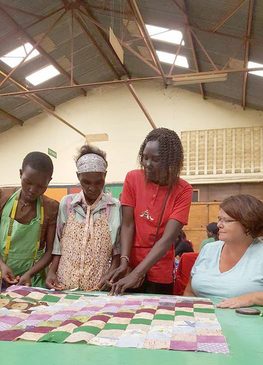 From left, Kenyan women Beatrice, Emily and Penny learn from Lynn Summers during an Imani Workshop. (Submitted photo)