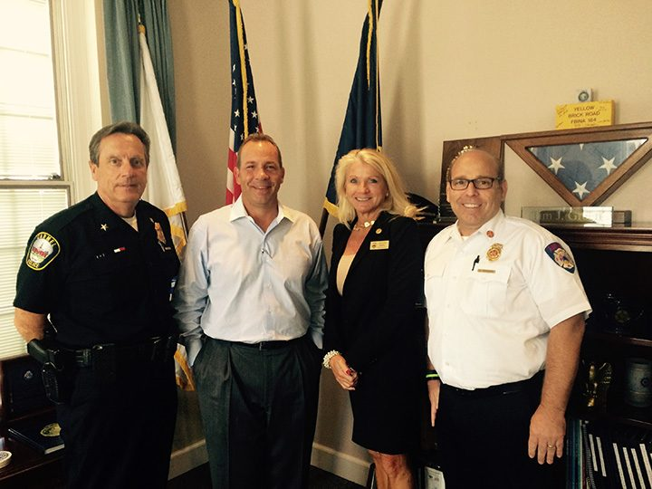 From left, Carmel Police Chief Tim Green, Bill Nicholls, Carmel Clerk Treasurer Christine Pauley and Fire Chief David Haboush. (Photo by Mark Ambrogi)