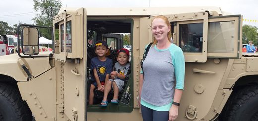 Hudson, Kellin and Carissa Pizarro of Fishers experience an army vehicle.