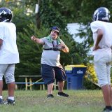 Chris Metcalf of Carmel coaches during a Cowboys practice Aug. 29 at Tabernacle Presbyterian Church. (Photo by Ann Marie Shambaugh)