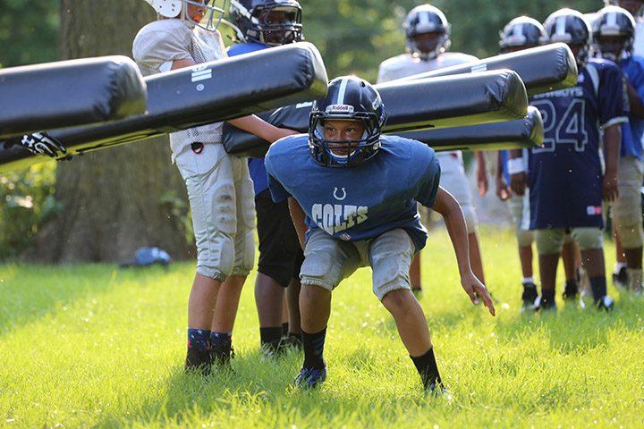 Evan Walker runs a drill at practice. (Photos by Ann Marie Shambaugh)