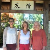 From left, Dawn Fraley, Lynda Pitz and Rosemary Waters in the entry gate that was donated to Carmel from Kawachinagano, Japan. (Photo by Anna Skinner)
