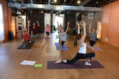 Anna Limauro (foreground) of Carmel teaches a yoga class at Blooming Life Yoga Studio in Zionsville. Limauro is among the youngest yoga instructors in the state. (Photo by Theresa Skutt)