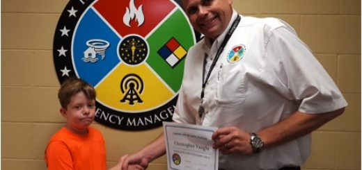 Christopher Vaught, 12, of Fishers and Heritage Christian School student, recently participated in an emergency services radio check drill at the Hamilton County Emergency Operations Center with Emergency Management Deputy Director Carl Erickson. Participation in the drill helped Vaught earn the Boy Scout's Emergency Preparedness merit badge. (Submitted photo)