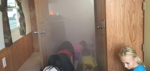 Throughout September, the Fishers Fire Dept. will teach elementary-aged students about fire and actions to take if a fire were to happen in their home. Students travel through a simulated smoke trailer to learn to stay below the smoke at Cumberland Road Elementary. (Photos by Anna Skinner)