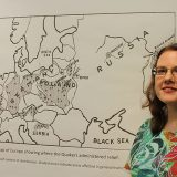 Nichole Mathews pauses by a map of Europe showing where Quakers administered relief after World War I and World War II. (Photo by Amy Pauszek)
