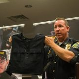 Lawrence Police Chief David Hofmann shows off the vest LPD officers will wear that holds the new BodyWorn cameras the department will be using. (Photo by Sam Elliott)