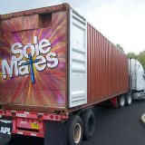 A semi truck full of donated shoes is packed for departure.