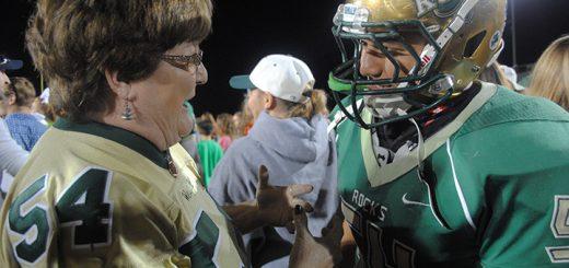 Karen Olinger congratulates David Mendoza after the WHS Shamrocks beat Zionsville Eagles Sept. 2. (Photo by Anna Skinner)