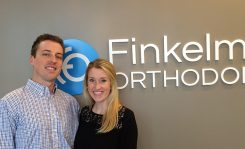 Brett Finkelmeier and his wife Nicole in his new Carmel orthodontics practice. (Photo by Mark Ambrogi)