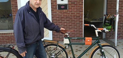 Accent Bicycles owner David Tortora with an electric bike. (Photo by Mark Ambrogi)