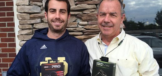 Eric Murphy (left) and father Pete display their ISOTunes products. (Photo by Mark Ambrogi)