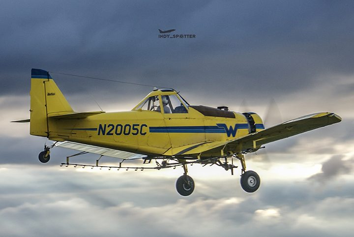 A crop duster departs a grass runway. (Photo by Alex Pegram)
