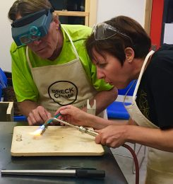 From left, Carmel jeweler Mark Grosser works with a student in Breckenridge, Colo. (Submitted photo).