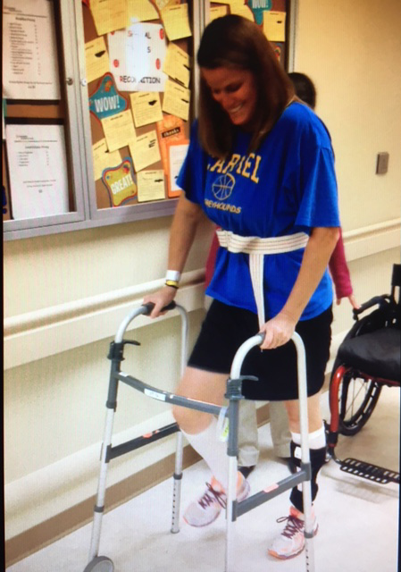 Melanie Brown uses a walker to relearn how to walk after being paralyzed by transverse myelitis in 2014.