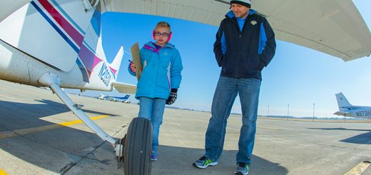 Samantha Stoeffler checks a plane with Flight1 founder Marcus Strawhorn before a flight. (Submitted photo)