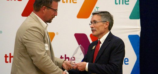 Hamilton Southeastern Schools Supt. Dr. Allen Bourff accepts the Youth Development Award from Fishers YMCA board chair Dan Irish, left. (Photos by Sadie Hunter)