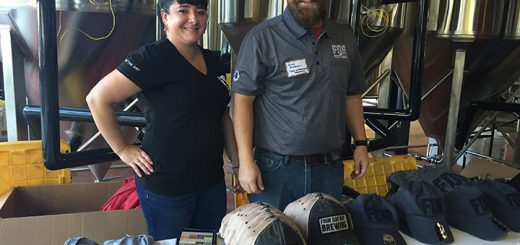 On Oct. 9, Four Day Ray Brewing Co. held the first of two open-house parties to welcome the public into the brewery. The brewery officially opens Oct. 19. Pictured, Erin Brown and Head Brewer Mitch Ackerman work at the apparel booth. (Photos by Anna Skinner)