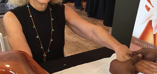 The Chernoff Cosmetic Surgeons 11th Annual Bazaar was held Oct. 6 to support the Survivors of Violence Foundation. Pictured, Sue Stahl receives a hand massage. (Photos by Anna Skinner)