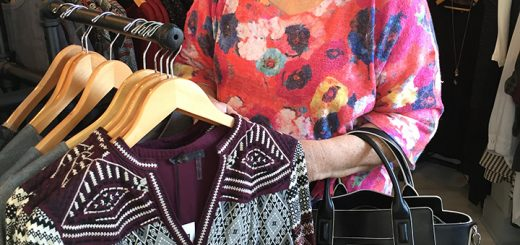 On Oct. 8, Bash Boutique celebrated its one-year anniversary at the Westfield location, 149 N. Walnut St. The store had specials and free coffee for those who attended. Pictured, Patty Trimble admires some clothing. (Photos by Anna Skinner)