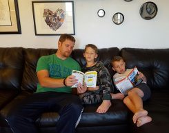 "From left, Michael, Owen and Christopher Lutomski read ""The Lemonade War."" (Submitted photo)"