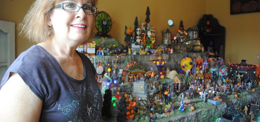 Jolie Renee with her Halloween village that she began creating in September. (Photos by Anna Skinner)