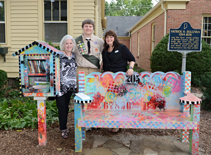 From left, Susan Albers, Skyler Keifer and Cynthia Young pause near the new Little Free Library and reading bench at the SullivanMunce Cultural Center. (Photo by Theresa Skutt)