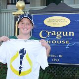 Fourth grader Audrey Mast of Zionsville displays her official torchbearer T-shirt. She is one of 11 Zionsville residents selected to carry the bicentennial torch through town. (Photos by Theresa Skutt)